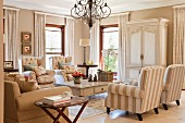 Sitting area in a traditional living room with a combination of bright, elegant country home furniture