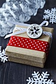 Festive gift box decorated with button and ribbons
