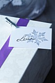 Present tag with stamped snowflake motif and miniature clothes peg