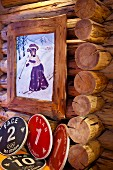 Painting of skiing cow in nostalgic clothing in rustic wooden frame