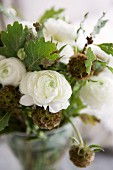 Bouquet with oak leaves and white ranunculus