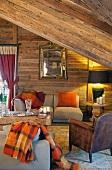 Comfortable attic living room in wooden cabin