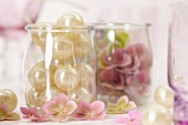 Beads and pink hydrangeas in jars