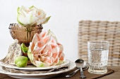 Festive place setting with pink amaryllis blooms