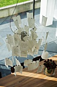 Ingo Maurer paper notes lamp hanging above dining table