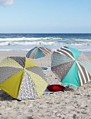 Designer parasols providing shade on sandy seaside beach