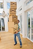 Man holding stack of packing boxes