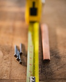 Tape measure, nails and pencil