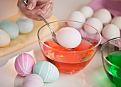 Woman colouring Easter eggs