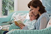 Mother reading to young daughter