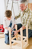 Father and son repairing stool