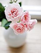 Vase of pink garden roses