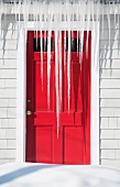 USA, Maine, Camden, icicles over red door