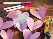 Studio shot of heart-shaped paper cutouts