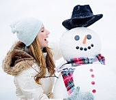 Profile of young woman with snowman