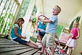 Children playing on porch