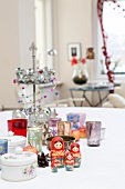 Christmas arrangement with Russian dolls on table