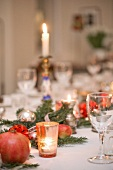 Christmas table in Berlin period apartment with historic prayer scrolls in background