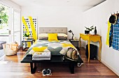 Sunny bedroom with bright yellow accents