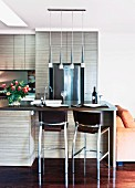 Open kitchen with breakfast bar and chrome bar stools