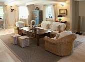 Upholstered, wicker sofa set, coffee table with drawers and solid wood, cubic stools in restored country house