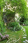Idyllic garden of former monastery with flagstone path and flowering plants