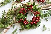 Small wreath of holly berries and conifer twigs
