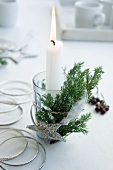 Arrangement with candle and sparkly star