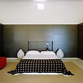 Japanese simplicity in bedroom with smooth wall panelling and rice paper lamps