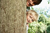 Germany, Cologne, Father and son smiling, portrait