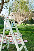 Picnic blanket and wooden ladder in garden
