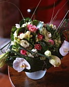 Bouquet with roses, freesias and ranunculus