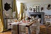 Set table in rustic dining room with various animal trophies on walls