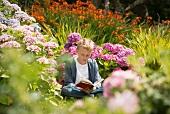 Boy reading in garden