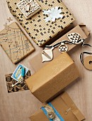 Presents wrapped in warm shades of brown; paper made from old crossword puzzles, printed with miniature stamps and decorated with painted outlines of keys