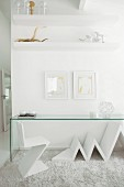 White, designer chair and minimalist glass table on flokati rug in front of partition in designer interior