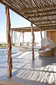 Sun terrace with rustic sun shade, mesh hammock and wide ocean vista