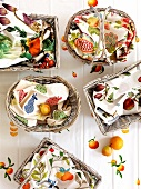 White-painted baskets covered with cheerful linen napkins