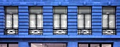 Row of windows at twilight (Pollen House, London, England)