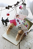 Decoration idea: folded book as postcard stand, pompoms
