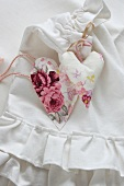 Hand-sewn fabric hearts on pleated laundry bag