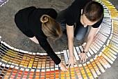 Couple choosing colour cards