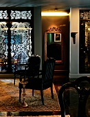 Stylish reception room with antiques, Persian rug and wall mirror (Hotel De Ville)