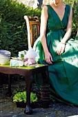 Woman taking tea in garden
