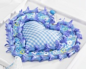 Blue fabric heart with hyacinth florets