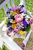 Spring bouquet on chair outdoors