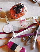 Hodge-podge of sewing utensils on table