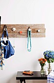 Wall coat rack with hooks made from door pulls