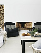 Seating group on white tile floor in front of an open brick fireplace and wall niches with stacked firewood