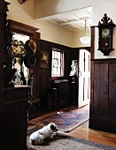 Entryway in a country home with dark wood paneling